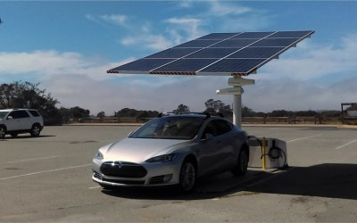 Solar EV charging station by Envision Solar with a Tesla charging