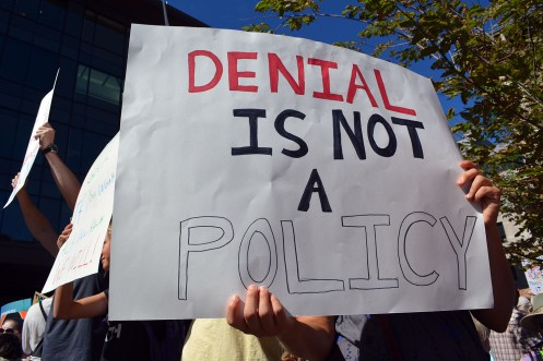 Denial sucks, as this sign accentuates.