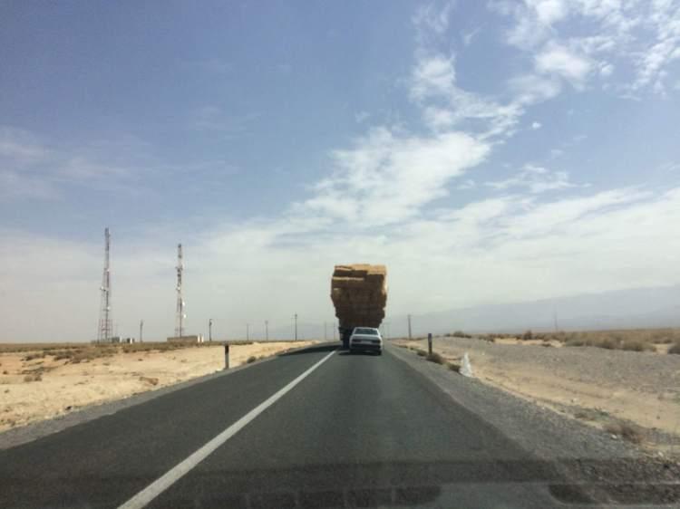 Behind a truck