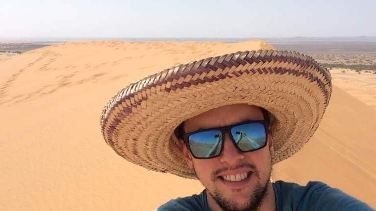 Walking in the Moroccan sand dunes