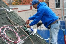 worker Installing panels on roof