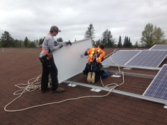 works installing solar panels on roof