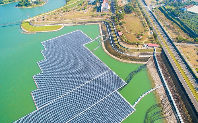 Aerial View of Floating Solar Panel Arrays on Water Surface