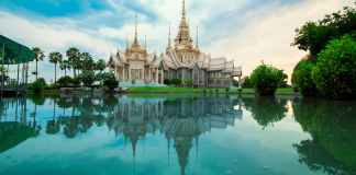 beige temple reflecting on body of water
