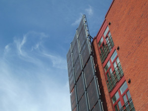 Solar Collectors On City Sky Rise