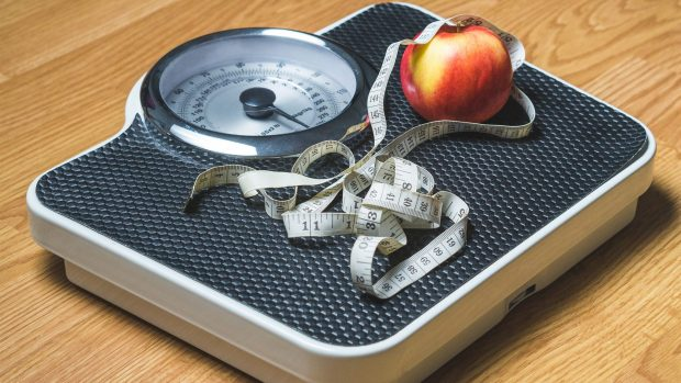 Weight loss photo of scale and apple