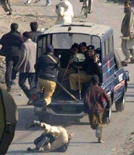 pakistan police man falling running van car