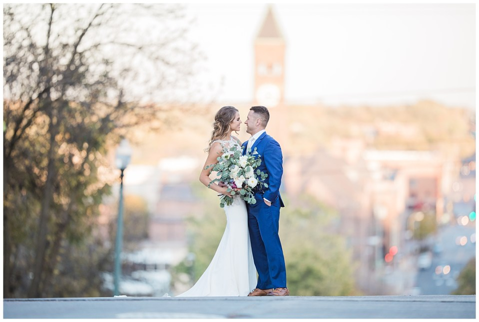 Bride and groom together on their wedding day with the city of Sioux Falls in the background.