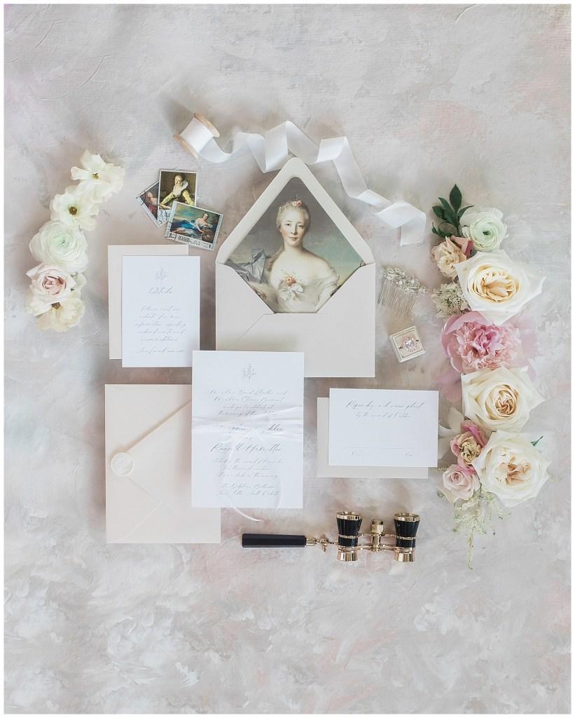 Flat lay of luxury wedding invitations during a fine art wedding photoshoot in South Dakota.