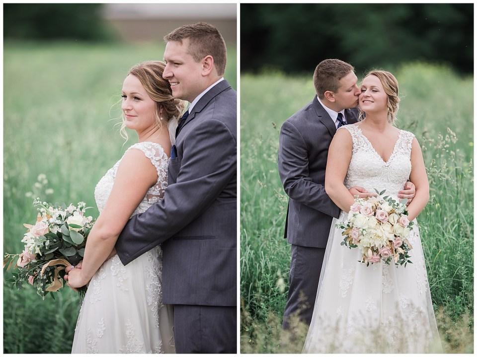 bride and groom hugging each other in a prairie in South Dakota. Groom kissing bride.
