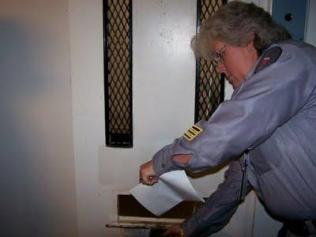 Corrections official delivering something to prisoner (Source: http://minutesbeforesix.blogspot.com)