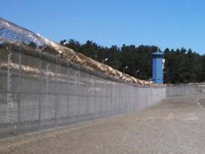 Pelican Bay prison tower and perimiter fence. [Katie Orr - Capital Public Radio]