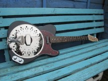 """A black Sollophonic with rosewood board neck, Hotrail pickup and red torty scratchplate. New owner says """"Magnificent. Has a fine tone, and fretting is easy, even with the heavy strings. Put it through my amp and it sounds ace""""."""