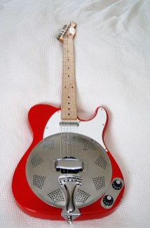 """Lovely Red and White and Chrome Sollophonic. Fender amp knobs on a chrome front mounted plate. Customer comments """"Looks even more beautiful than in the pictures on your website""""."""