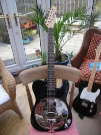 """Recent conversion, black with a Hotrail. Customer comments\""""What can I say, an incredible piece of gear. Played through my Champion600 it sounds so authentically rootsy. Youve really got something there, Im going to spread the good word. Thank you very much!"""