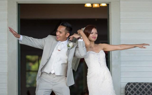 Bride & Groom entering their reception at Olowalu Plantation House, Maui Hawaii