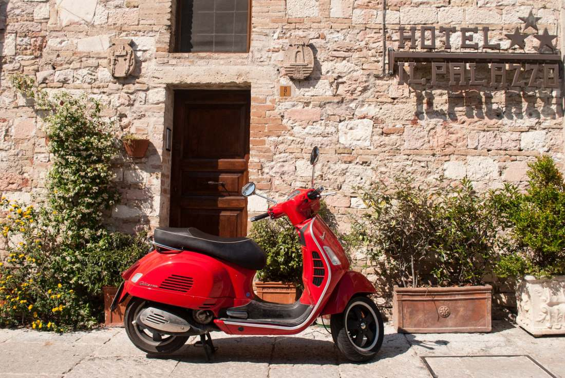 Red Scooter Parked Outside the Hotel IL Palazzo in Assisi Italy