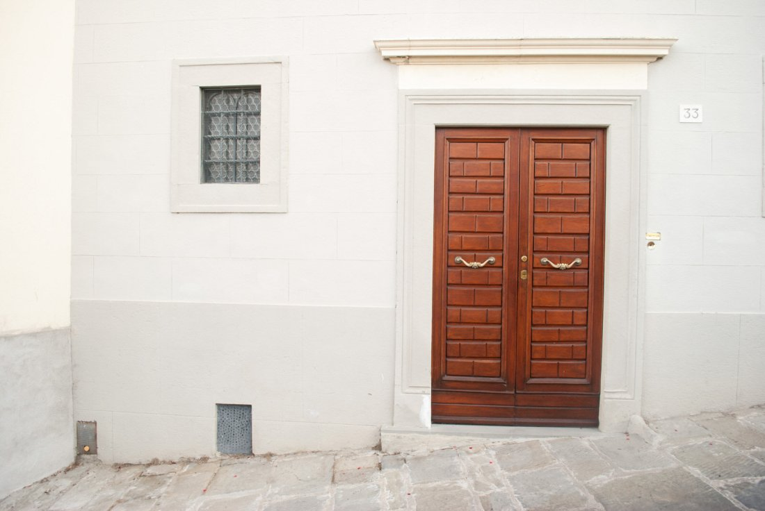 A door against a white wall in Cortona
