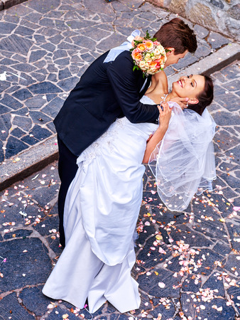 38740256 - groom carries his bride over back. outdoor.