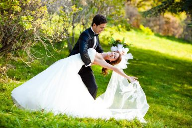 8744379 - dancing wedding couple at a park on a sunny day