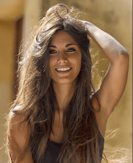 Beautiful and altogether Lovely woman.  Sweet smile.  Long glorious brown hair.  Delightful Cheeks.