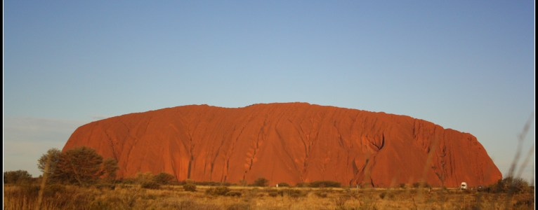 Changing colours of the big Sacred rock (Uluru)