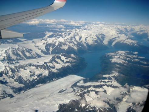 View of a Glacier, a Lake and Mountains from Flight into Anchorage International Airport