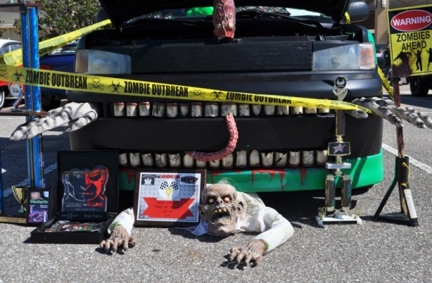 Zombie Crawling Under Car, Spooky Empire, Orlando, Fla., Oct. 26, 2013