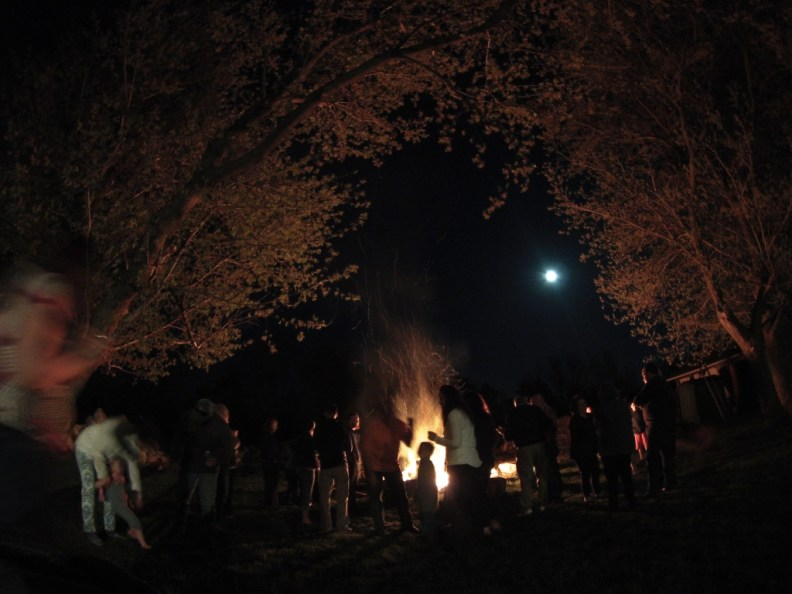 Family with a Bonfire and Full Moon