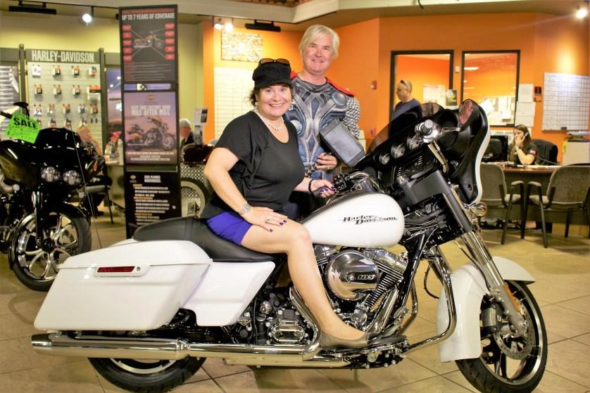 How do I look on a Harley-Davidson? Here I am with dealer owner Bert King of Bert's Black Widow Harley-Davidson, Port Charlotte, Fla.