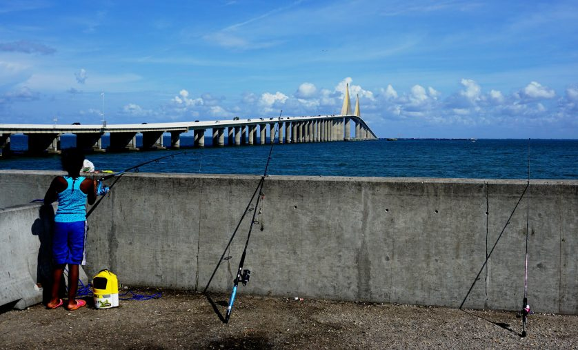 A Little Girl Fishing From the Skyway Fishing Pier.
