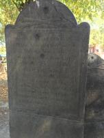 "Captain Malcolm's tombstone which states ""An enemy to oppression and one of the foremost in opposing the revenue acts on America"". The British troops used it for target practice"