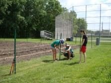 Interns building the Youth Farm fence
