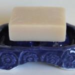 Photo of bar soap on soap tray