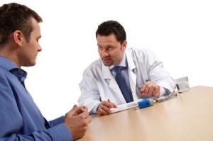Doctor talking to man about leaky gut problems