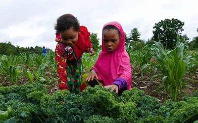 Two Somali Bantu children in the field at Liberation Farms