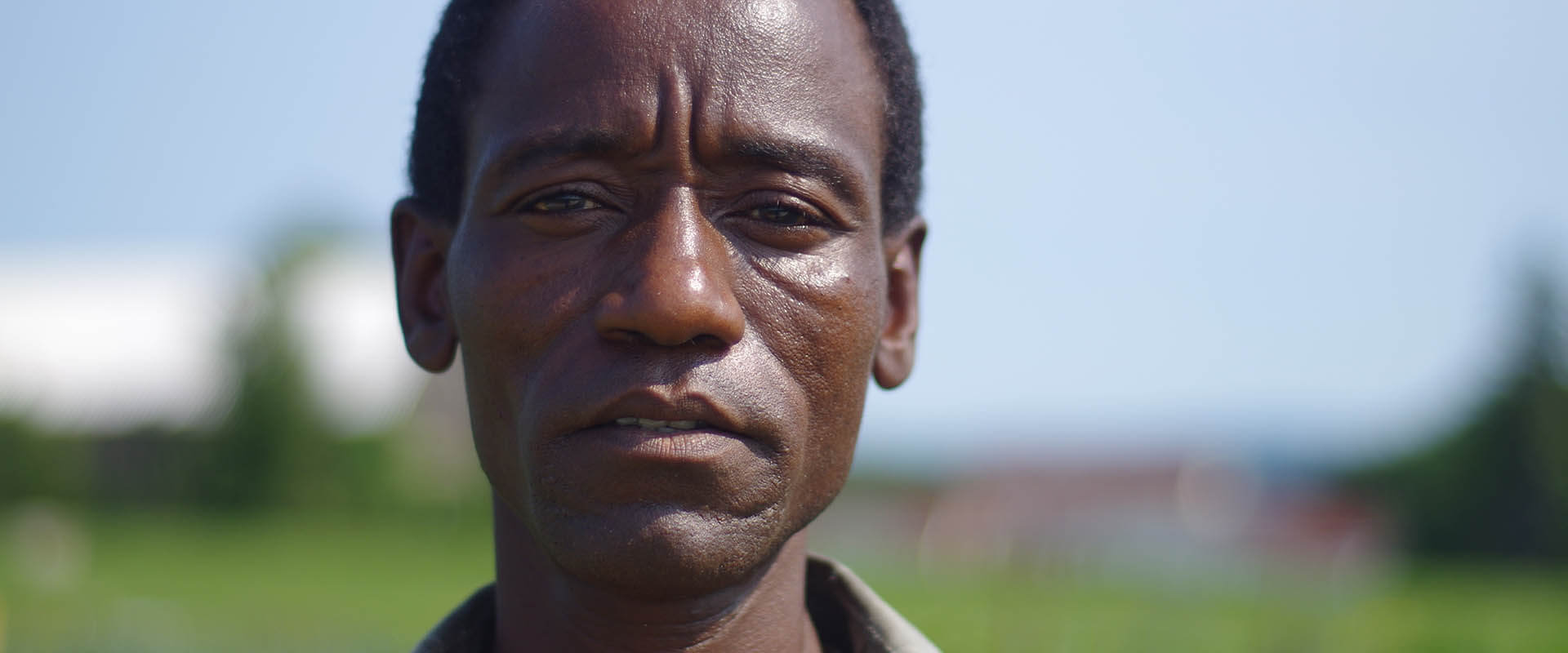 A Somali Bantu man out in the fields