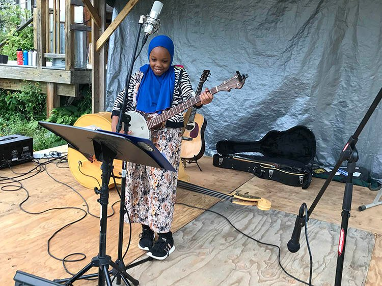 Somali Bantu girl playing guitar