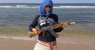 Zaina holding an AK47