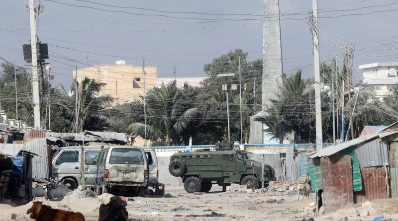 An armoured personnel carrier drives on a street which is sealed off to prevent protests in Mogadishu2