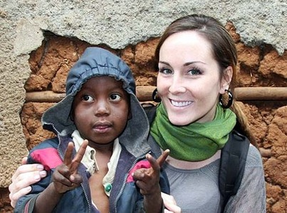 Canadian freelance journalist Amanda Lindhout sits with a child in Mogadishu, Somalia,