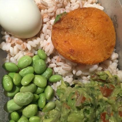 Three grain rice, butternut squash disc, edamame beans, chunky guacamole and egg