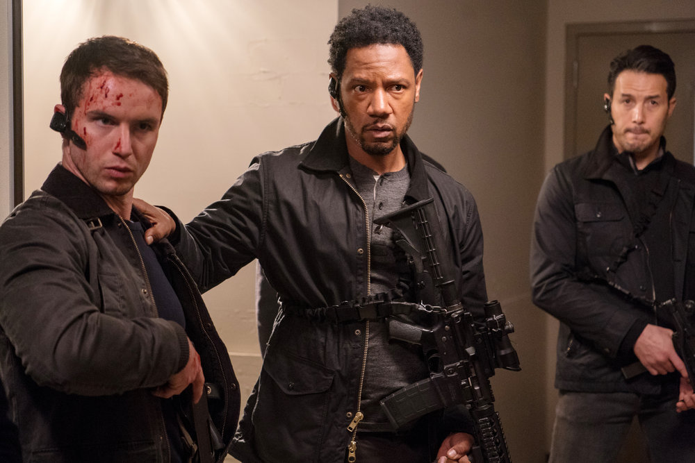 """COLONY -- """"Bonzo"""" Episode 312 -- Pictured: (l-r) Will Brittain as Dave O'Neill, Tory Kittles as Broussard -- (Photo by: Daniel Power/USA Network)"""