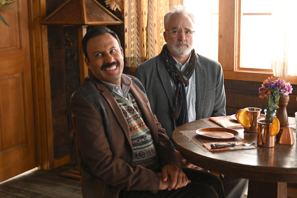 "PERFECT HARMONY -- ""Thanks-Taking"" Episode 109 -- Pictured: (l-r) Rizwan Manji as Reverend Jax, Bradley Whitford as Arthur -- (Photo by: Mitchell Haddad/NBC)"