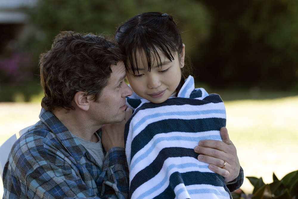 "COUNCIL OF DADS -- ""Heart Medicine"" Episode 106 -- Pictured: (l-r) Tom Everett Scott as Scott Perry, Thalia Tran as Charlotte Perry -- (Photo by: Seth F. Johnson/NBC)"