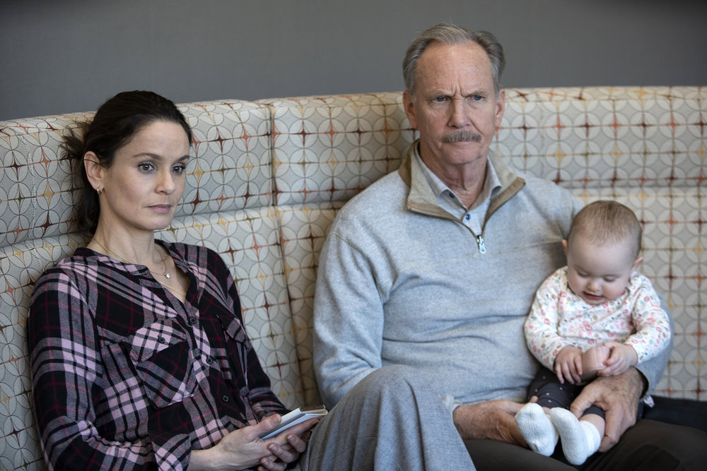 "COUNCIL OF DADS -- ""Heart Medicine"" Episode 106 -- Pictured: (l-r) Sarah Wayne Callies as Robin Perry, Michael O'Neill as Larry Mills, Baby Hope -- (Photo by: Nathan Bolster/NBC)"