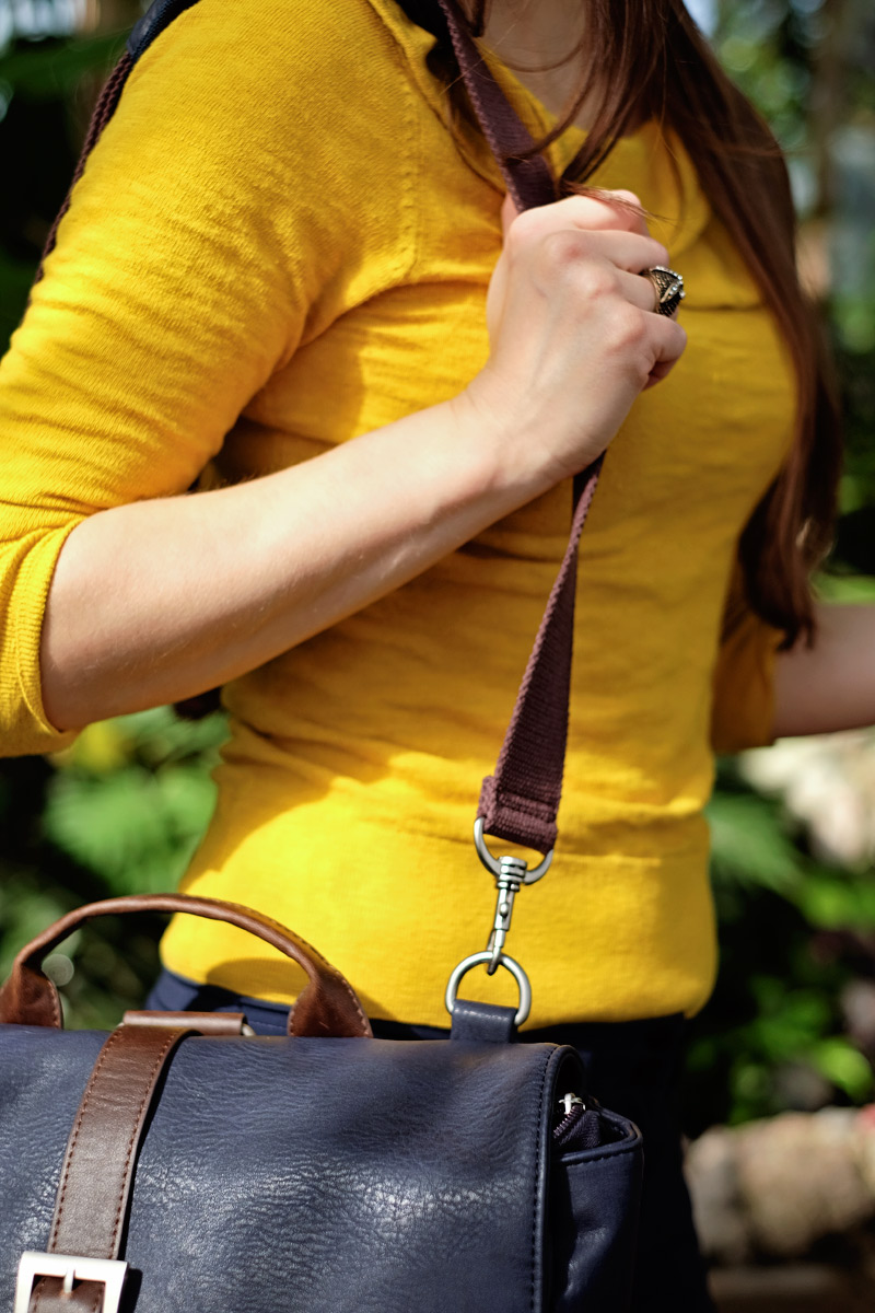 The Chapel bag worn with shoulder strap.