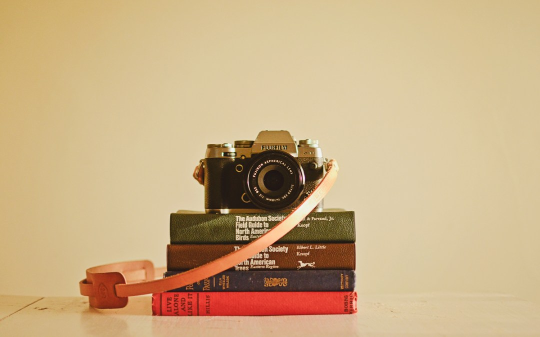 Fuji X-T1 resting on vintage books