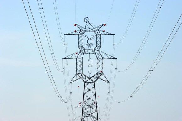 Electric pylons resemble clowns near a motorway in Hungary