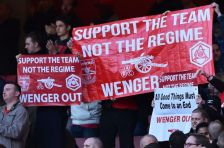 "Arsenal fans hold up banners calling for ""Wenger Out"", referring to Arsenal's French manager Arsene Wenger, during the English Premier League football match between Arsenal and Norwich at the Emirates Stadium in London on April 30, 2016. / AFP / BEN STANSALL / RESTRICTED TO EDITORIAL USE. No use with unauthorized audio, video, data, fixture lists, club/league logos or 'live' services. Online in-match use limited to 75 images, no video emulation. No use in betting, games or single club/league/player publications. / (Photo credit should read BEN STANSALL/AFP/Getty Images)"